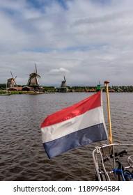 ZAANDAM, NORTH HOLLAND, THE NETHERLANDS - JULY 29, 2017: Windmills in Zaanse Schans.