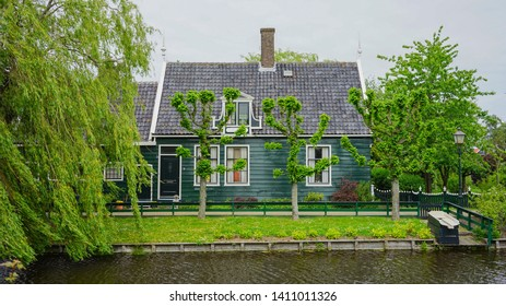 Zaanse Schans, Amsterdam - May 24 2019:  An old house in Zaanse Schans by the canal.