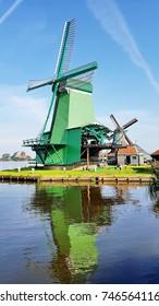 ZAANSE SCHANS - AUGUST 2017: Windmills on August 28, 2017 in Zaanse Schans. Well-preserved historic windmills in the neighbourhood of Zaandam, near Zaandijk, Netherlands.