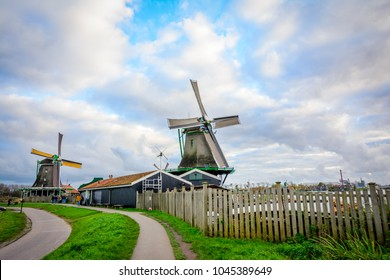 Zaanse Schans is a neighbourhood of Zaandam, near Zaandijk, Netherlands, with a collection of well-preserved historic traditional windmills and houses, offering a preserved glimpse into Holland's past