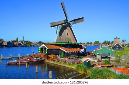 ZAANSE SCHANS NETHERLAND OCTOBER 01 2015: Zaanse Schans is a neighbourhood of Zaandam in the municipality of Zaanstad in the Netherlands. It has a collection of well-preserved historic windmills