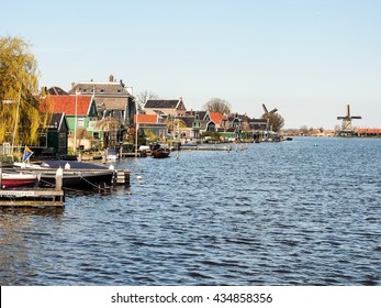 ZAANSE SCHANS , NETHERLANDS - APR 10, 2016: Riverside village near  the old windmills site, ZAANSE SCHANS , Netherlands. This village is one of the popular tourist attractions of the Netherlands.