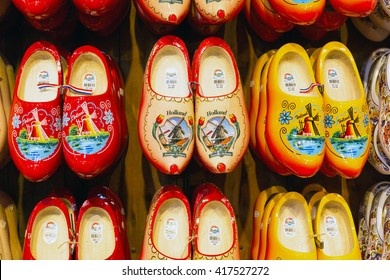 Zaanse schans, Netherlands - April 1, 2016: Many dutch traditional wooden shoes or clogs for sale in shop