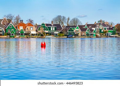 Zaanse schans, Netherlands - April 1, 2016: Row of old dutch green traditional houses in town Zaanse Schans in Netherlands, North Holland near Amsterdam, copy space, place for text