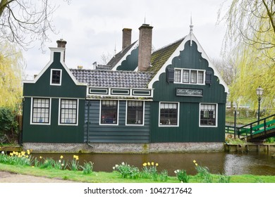 ZAANSE SCHANS, NETHERLANDS - APRIL 11, 2017: visit museum historic and dutch house style at Dutch windmills of Zaanse Schans