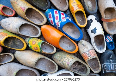 ZAANSE SCHANS, NETHERLANDS - APRIL 4, 2015: Traditional dutch wooden shoes hanging on a wall as decoration. For the production of clogs they mostly use soft wood (poplar or willow wood).