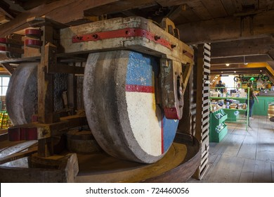 ZAANSE SCHANS, NETHERLANDS - AUGUST, 28, 2017: People who buy millstone and traditional products inside the old windmill