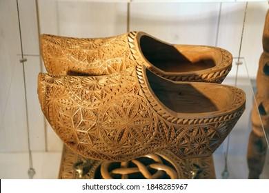 ZAANSE SCHANS,  NETHERLANDS - DEC 12, 2018 - Vintage Dutch wooden shoes in local museum of Zaanse Schans, Netherlands