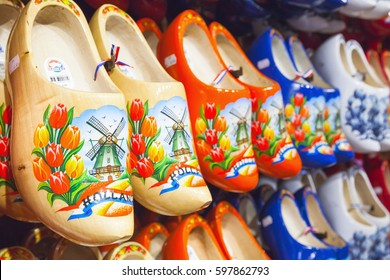 Zaanse Schans, Netherlands - February 25: Dutch clogs made of poplar wood, traditional shoes with colorful paintings stand on souvenir shop counter