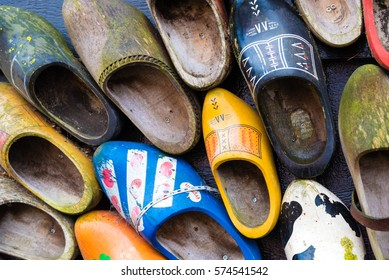 Zaanse Schans, Netherlands - January 10, 2017: Traditional handmade Dutch wooden shoes in Zaanse Schans village near Amsterdam, Netherlands. Klompen are whole feet clogs made of willow or poplar.