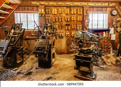 ZAANSE SCHANS, NETHERLANDS - JULY 08, 2015: Vintage machine tools in small workshop in Zaanse Schans producing klompen (clogs) - famous traditional dutch footwear made completely from wood.