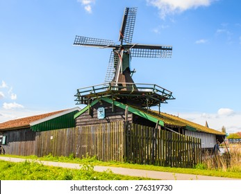 ZAANSE SCHANS, NETHERLANDS - MAY 2, 2015: Nature and windmills in Zaanse Schans, Northe Holland, Netherlands. This village is a popular touristic destination in Netherlands