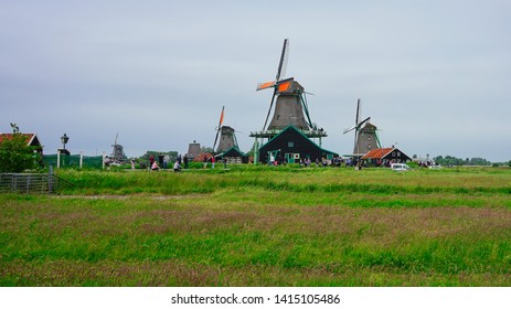 Zaanse Schans, Netherlands - May 24 2019:  Old historic windmills village by the Zaan river near Zaandam.