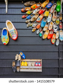 Zaanse Schans, Netherlands - May 24 2019:  Traditional Dutch wooden shoes decorated on the wall in Zaanse  Schans village.