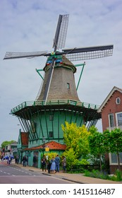 Zaanse Schans, Netherlands - May 24 2019:  A road with a famous windmill leading to an old Dutch town in Zaanse Schans.