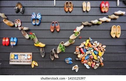 Zaanse Schans, Netherlands - May 24 2019:  Traditional and colorful Dutch wooden shoes decorated on the wall in Zaanse  Schans village.