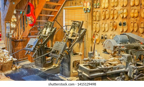 Zaanse Schans, Netherlands - May 24 2019:  Traditional Dutch shoe workshop shows how to make a wooden clog.