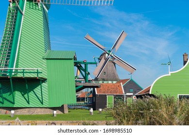 ZAANSE SCHANS, NETHERLANDS - OCTOBER 13, 2018: Traditional windmill in the Zaanse Schans, a neighborhood with historic wooden buildings in the municipality of Zaanstad.