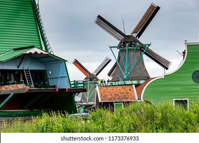 Zaanse Schans in the north of Amsterdam - area with many wind mils on a cloudy day, Netherlands