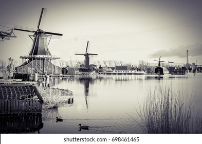 Zaanse Schans windmills by the River Zaan in black and white, Holland