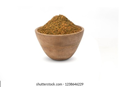 Za'atar in a wood bowl isolated on white . Zatar .  Middle Eastern spice mixture .