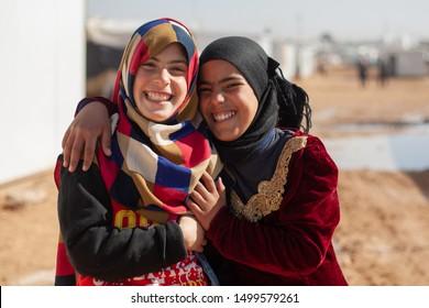 Zaatari Village, Amman / Jordon - January 14 2015: Cheerful Syrian refugee friends smiling to the camera