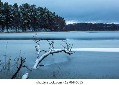 Zabinki lake at winter near Kruklanki, Masuria, Poland