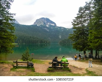 ZABLJAK, MONTENEGRO, 15 JUNE 2015: People trekking around the Black Lake (Crno Jezero) in the Durmitor National Park