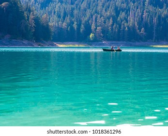 ZABLJAK / MONTENEGRO - AUGUST 18 2017: A boat in Black Lake at sunny summer day. Durmitor National Park,  Zabljak, Montenegro