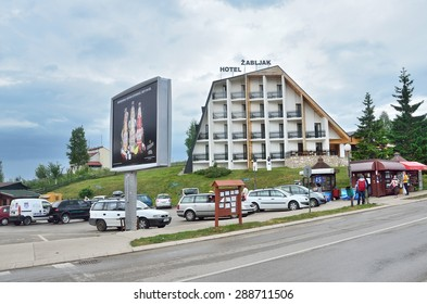 Zabljak, Montenegro, June,15, 2015. Montenegro scene: People walking near hotel Zabljak in Zabljak mountain resort
