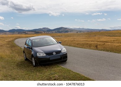 Zabljak, Montenegro - September 19: car with the traveler stands on the roadside in a yellow field in zabljak in the European day of languages on September 19, 2017