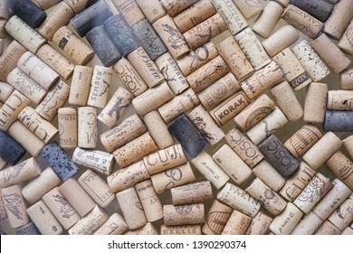 Zabreb, Croatia - April 14, 2019 : A glass display with pile of wine corks with a variety of logos and names such as Korak, Cuj and Jisoc.