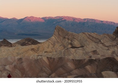 Zabriskie Point in Death Valley National Park showing the Manly Beacon in the foreground with beautiful dawn light.