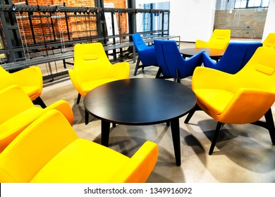 ZABRZE, POLAND - MARCH 16, 2019: Colorful chairs with table in a waiting room of Queen Louise old mine shaft.