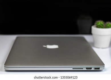 ZABRZE, POLAND - March 31, 2019: Apple MacBook Pro, designed and developed by Apple Inc. with cactus in a white pot.