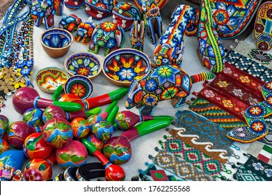 Zacatecas, Mexico - October 25, 2006: Colorful folk art made by indigenous Huichol Indians, renowned for their crafts. The designs incorporate traditional symbols that date back centuries.