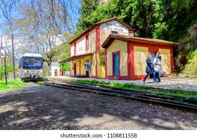 Zachlorou, Peloponnese / Greece - April 10, 2013: The Odontotos train at the Mega Spileon station in Zachlorou village (Diakofto - Kalavrita route). Young couple just disembarked from the train