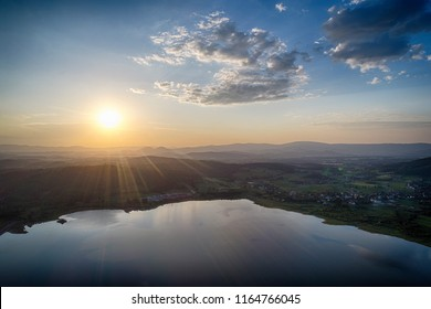 Zachod slonca nad jezioerm, widok z powietrza. Sunrise, lake, mountains  - Shutterstock ID 1164766045