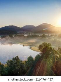 Zachod slonca w gorach, widok z powietrza, Sunset in the mountains - Shutterstock ID 1164764437