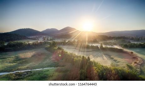 Zachod slonca w gorach, widok z powietrza, Sunset in the mountains - Shutterstock ID 1164764443
