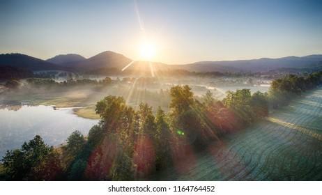 Zachod slonca w gorach, widok z powietrza, Sunset in the mountains - Shutterstock ID 1164764452