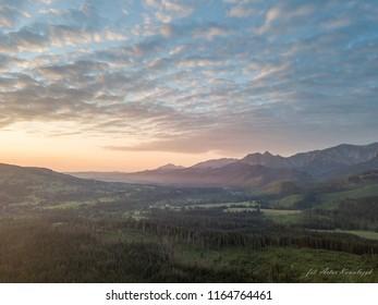Zachod slonca w gorach, widok z powietrza, Sunset in the mountains - Shutterstock ID 1164764461