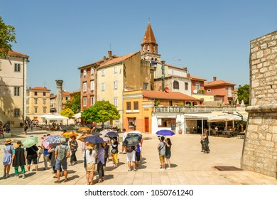 Zadar / Croatia - 10 August 2017: Tourists view the sights and take photos in the streets of Zadar