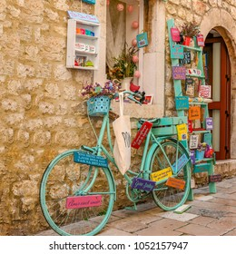 Zadar / Croatia - 10 August 2017: Bicycle decorated with flowers and colored wooden plaques with inscriptions
