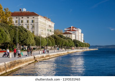 Zadar, Croatia - 7 October, 2010: Old Town, tourists and locals on popular tree-lined promenade by the Adriatic Sea, Dalmatia County
