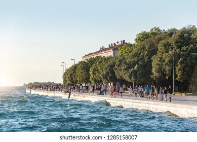 ZADAR, CROATIA - JULY 14, 2017: The embankment of the city of Zadar on a sunny summer day. Zadar, one of the most popular cities in Croatia in the tourist season.