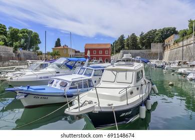 ZADAR, CROATIA - JULY 15, 2017: Boats on the pier in the resort town of Zadar, Croatia.