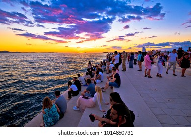 ZADAR, CROATIA - July 18 2017:  Unidentified people on Zadar sea organs at sunset. Many tourists visits unique architectural object  - musical instrument powered by the sea streams.