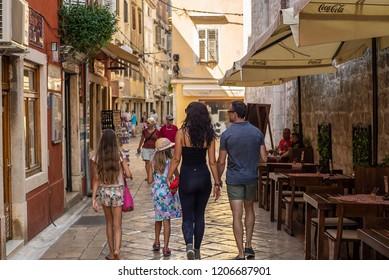 ZADAR, CROATIA - SEPTTEMBER 2018. Family walking in the ols streets of Zadar, Croatia.