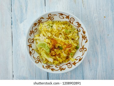 Zafrani Pulao - Basmati rice cooked in a sweet and rich blend of spices and nuts.